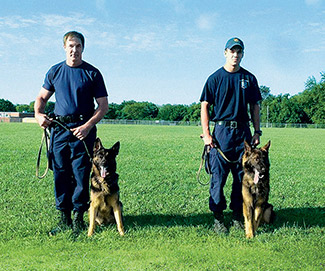 Like father, like son: Dave Roesler and his son, Stephen, are both K-9 officers with the Baltimore Police Department, which has the state's second-oldest K-9 unit.